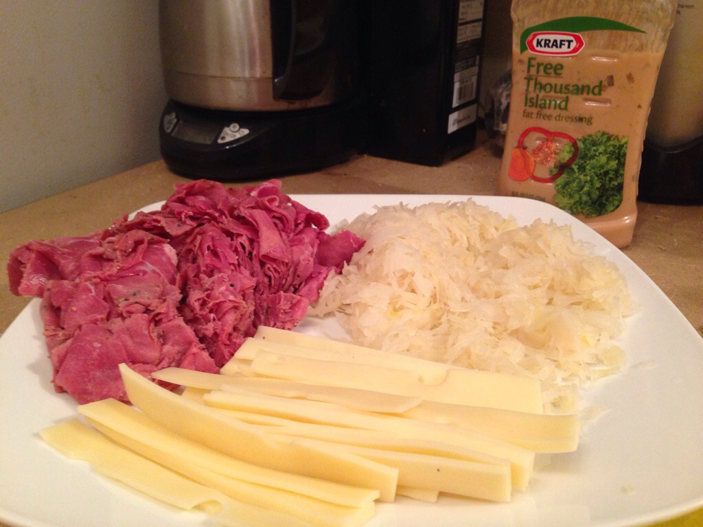 Corned Beef/Pastrami, sliced swiss cheese, drained and warmed sauerkraut. And Fat Free Thousand Island