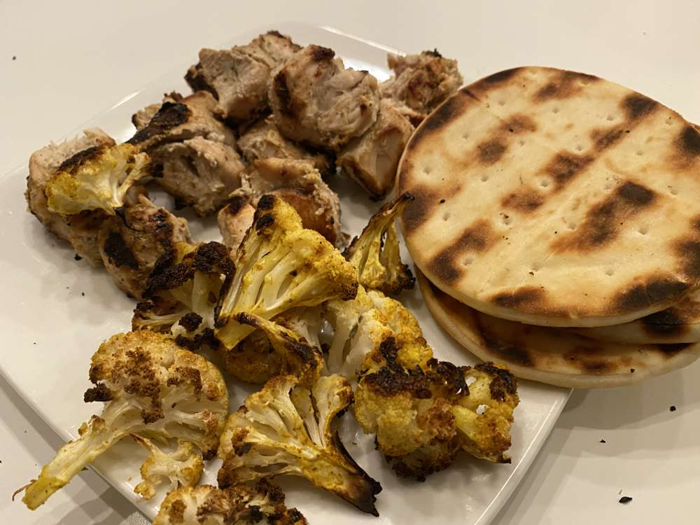Served with grilled naan and curried cauliflower